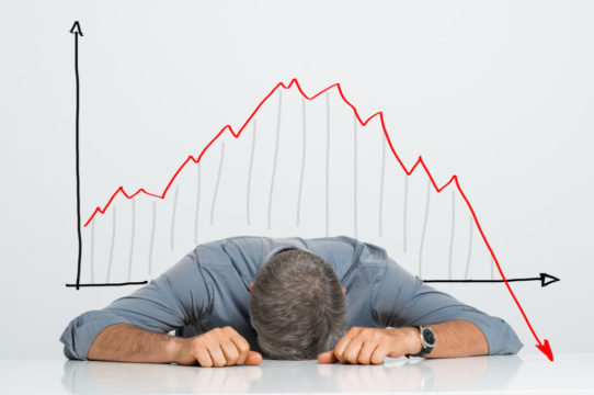 17_10_31-man-with-head-on-table-and-graph-behind-heading-down_gettyimages-518546769-1.jpg