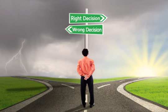 man-with-right-and-wrong-decision-signs-1.jpg