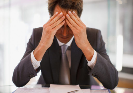 stressed-out-man-in-suit_gettyimages-109350399-1.jpg