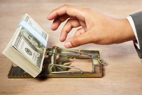 value-trap-mouse-trap-hand-with-money-getty-1.jpg
